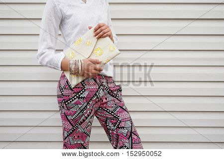 Young woman with fashion details on planks background