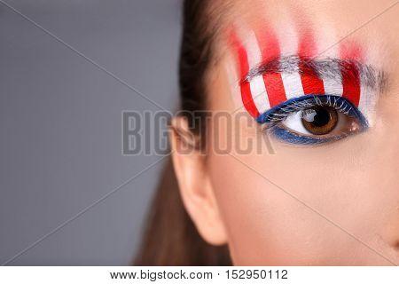 Girl eye with USA makeup, closeup