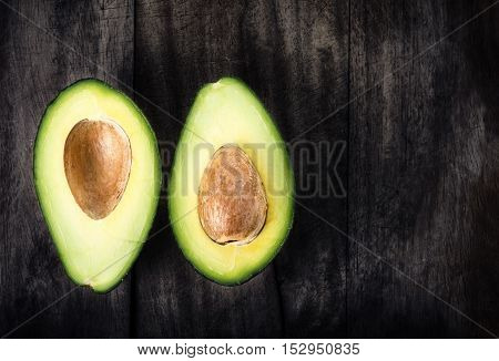 Fresh Green Avocado on on old wooden table with copy space