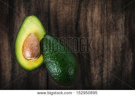 Avocado on a dark wood background close up