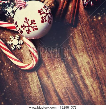 Christmas decorations on wooden background in vintage style. Christmas concept style. Festive Xmas Card