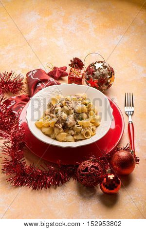 pasta with mushroom over red christmas table