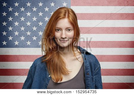 Us Citizenship And Patriotism Concept. Portrait Of Pretty American Girl With Long Red Hair Wearing D