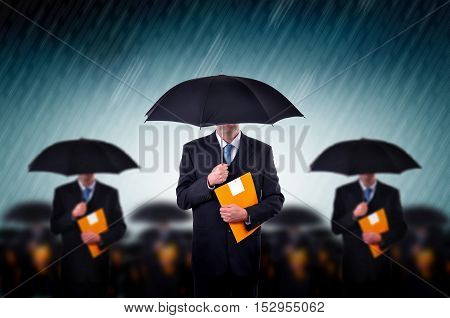 Businessmen with umbrella standing in stormy rain. Business team, insurance agents and consultants in business crisis situation.