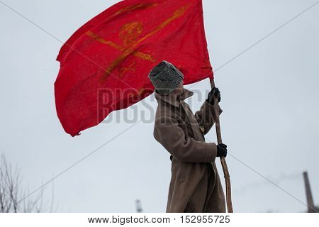 Historical reconstruction. Red Guard with a flag. The person holds a red flag.