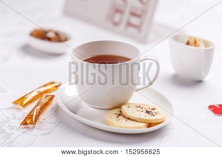 White cup of tea with biscuits, tea time