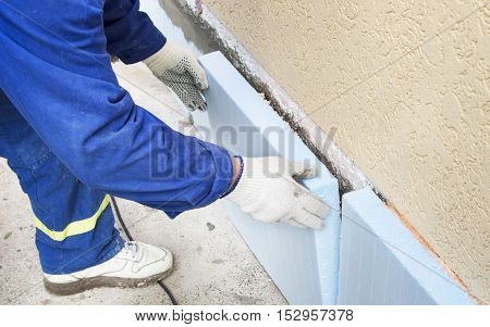 The Process Of Gluing Blue  Polystyrene