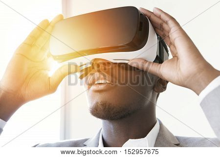 Portrait Of Astonished African Office Worker Or Businessman Using Oculus Rift Headset, Experiencing