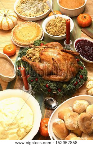 Roasted turkey, bread and pies for Thanksgiving Feast