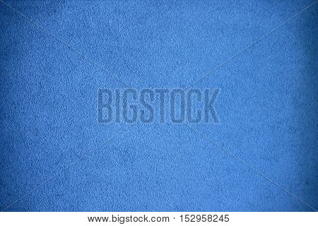 A grainy grungy background in light blue.