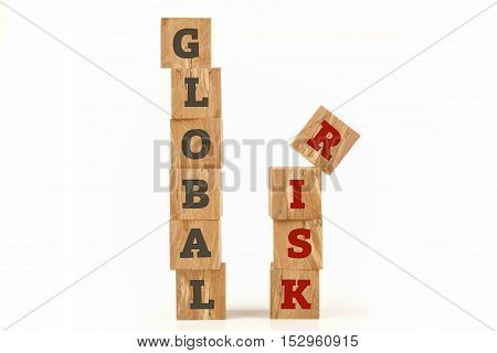 Global Risk word written on cube shape wooden surface isolated on white background.