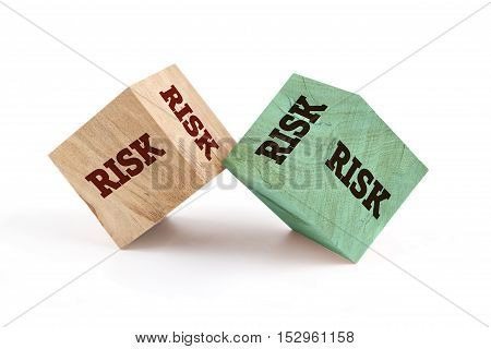 Risk word written on cube shape wooden surface isolated on white background.