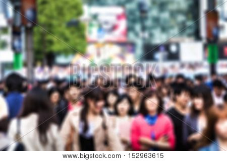 Blurred photo of people walking at a busy street in Tokyo, Japan