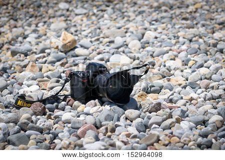 PALEOCHORA, CRETE, GREECE - JULY 2016: Nikon D700 camera at stony beach of Paleochora town on Crete island, Greece