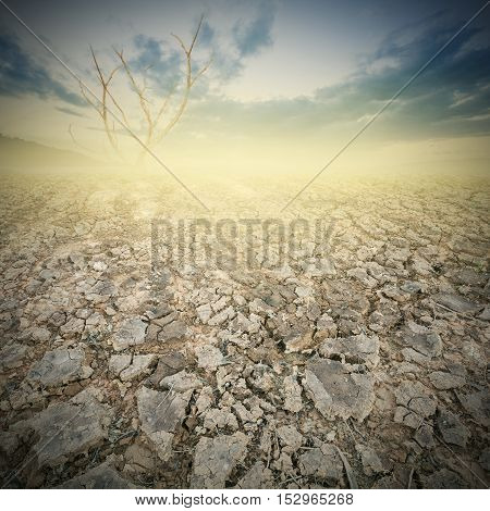 land and cracked earth with dramatic sky over cracked earth