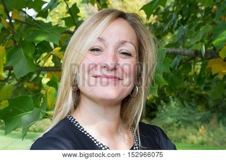 Attractive Middle-aged Blond Woman With A Beautiful Smile