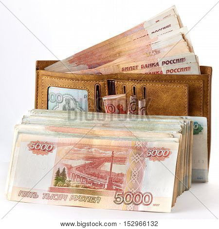 A lot of russian money roubles in wallet. Isolated object on white.