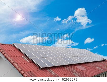 solar cell panel on red roof and cloud blue sky Energy saving concept