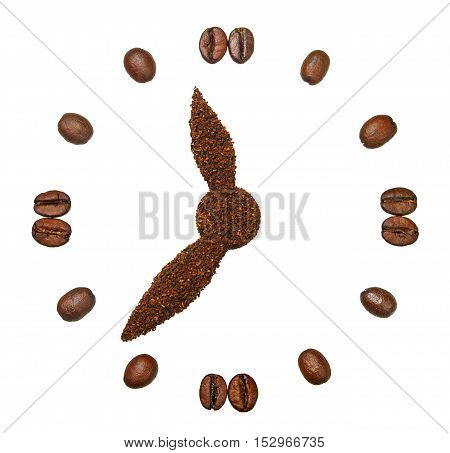 Ground coffee and coffee beans in the form of hours isolated on white