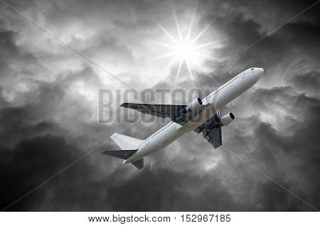 Airplane On Dark Stormy Sky And Sun