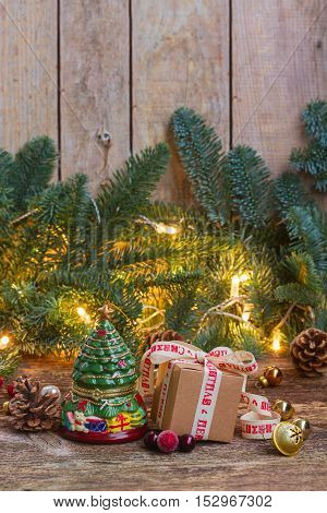 One handmade gift box with evergreen tree on wooden background