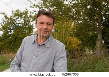 an Handsome middle age man outdoor smiling
