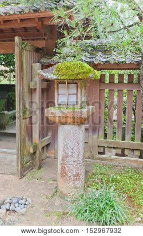 UJI JAPAN - JULY 27 2016: Traditional stone lantern (toro) in Ujigami Shinto Shrine in Uji city near Kyoto. Ujigami Shrine was founded in 11th c. UNESCO site