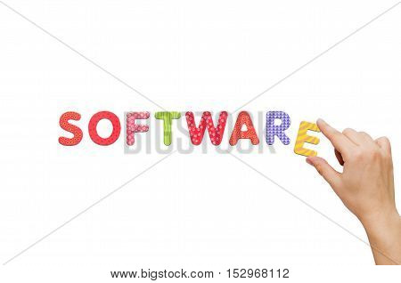 Hand put the word Software with magnetic letters. Colorful alphabet kit