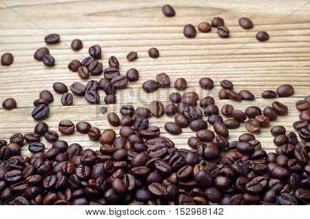 Coffee beans on a a wooden background