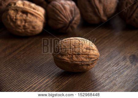 walnut on the wooden-table.Walnut, Nut - Food, Variation, Food, Seed
