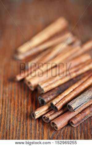 Sticks of cinnamon on the old wooden table