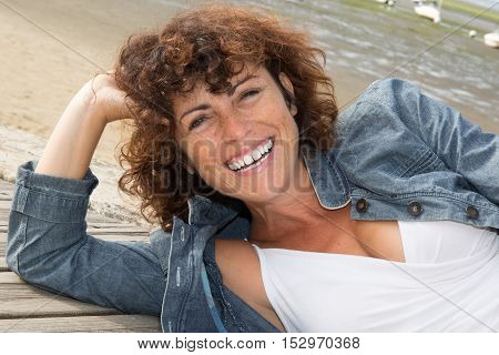 Pretty Brunette Laughing At Camera On A Sunny Day