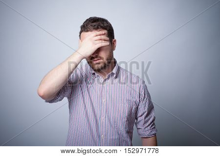 Man Depressed With Hand On His Head