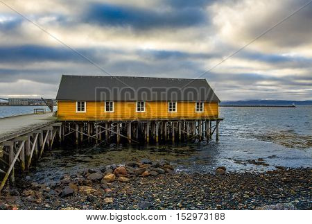 The Factory Pier (fabrikkaia) in Vadso, Finnmark county, Norway. Build in 1878. Partly ruined by fire in 1908, but rebuild. One of the few piers not blown by the germans during the end of world war 2.