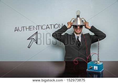 Authentication text with vintage businessman and machine at office