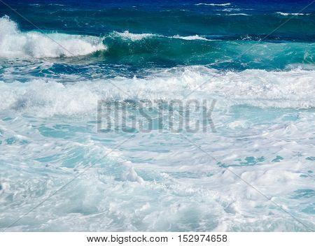 blue sea of white foam on the island of Cyprus close up
