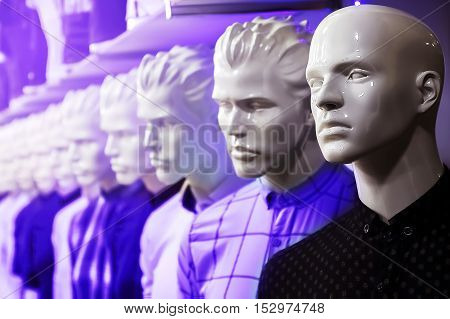 dummy in the department of menswear in neon light