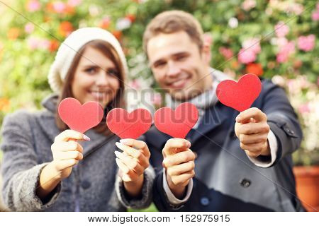 Picture of happy couple having fun with hearts