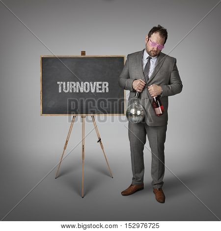 Turnover partyman text on blackboard with businessman and key