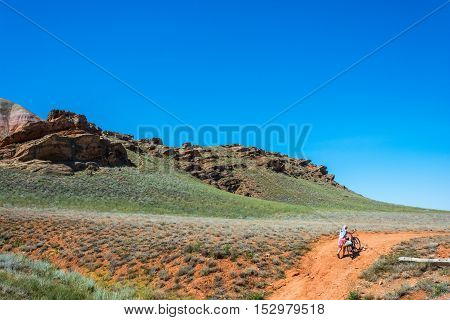 Biking on mount Big Bogdo Nizhniy Baskunchak Arkhangelsk oblast Russia.