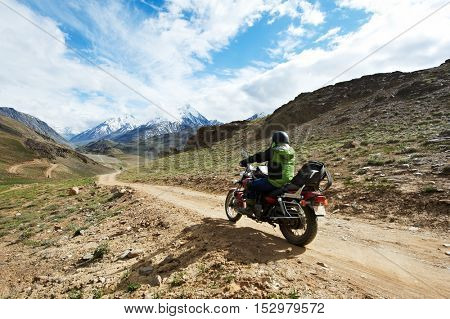 Motorbike tourism. Traveller at motorcycle in mountains