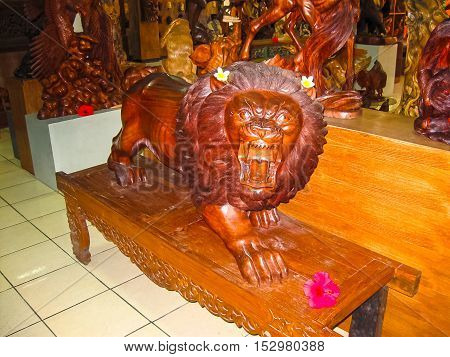Ubud Indonesia - April 12 2012: Carved wooden animal statue in shop at Ubud Indonesia