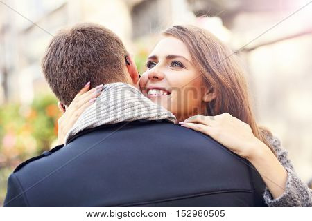 Picture showing happy couple hugging in the city