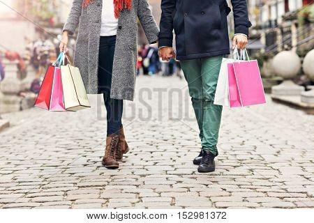 Downsection showing couple shopping in the city