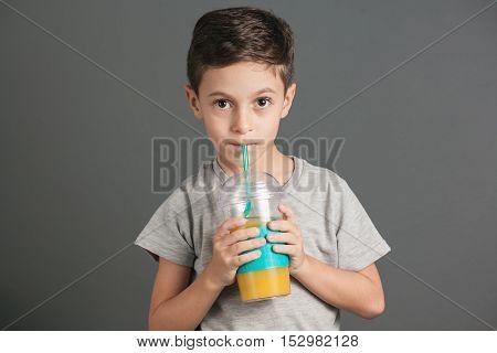 Little Funny Boy Drinking A Fresh Cola Juice Through A Straw
