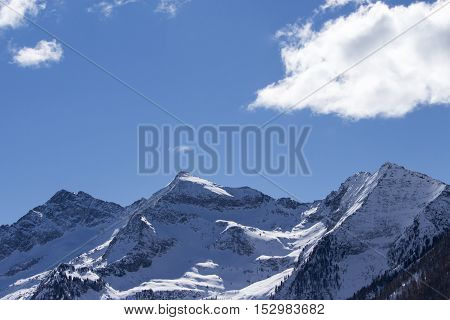 Alpine Landscape With Mountains, Trees And Snow