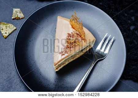 Banana caramel mousse cake with milk chocolate glaze.