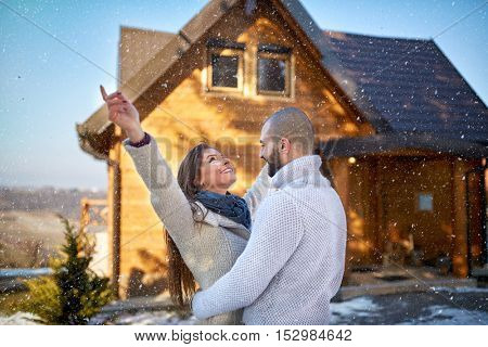 Happy girl and man on winter holiday on mountain