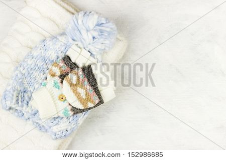Warm woolen clothes on a white background