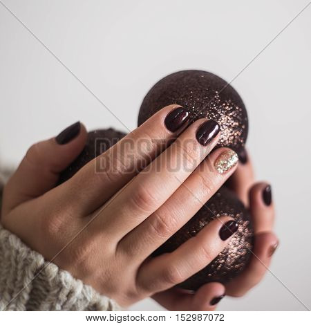 Woman's Hands With New Year Toy Christmas Tree